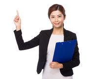 Businesswoman hodling with clipboard and finger point up Stock Photos