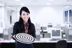 Businesswoman hold bull's eye at office Royalty Free Stock Image