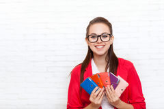 Businesswoman hold business cards wallets happy smile wear red jacket Royalty Free Stock Images