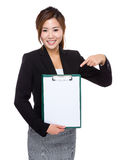 Businesswoman hold clipboard with with finger point to blank pap Royalty Free Stock Photo