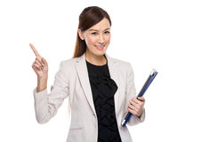 Businesswoman hold clipboard and laptop finger up Royalty Free Stock Photos
