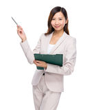 Businesswoman hold clipboard and pen point out Royalty Free Stock Images