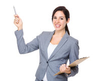 Businesswoman hold with clipboard and pen point up Stock Images