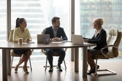 Businesswoman hold discussion at office business meeting. Middle aged businesswoman talk on business meeting in office with company partners, female boss discuss stock photos