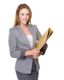 Businesswoman hold with folder Stock Image