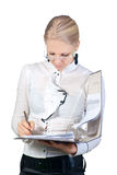 Businesswoman hold a folder of papers and write Stock Photos