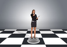 Businesswoman hold folder and pointing finger at Royalty Free Stock Photo