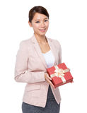 Businesswoman hold with gift box to you Royalty Free Stock Image