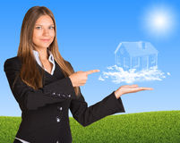Businesswoman hold house of clouds Stock Photos