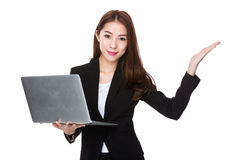 Businesswoman hold with laptop and open hand palm Royalty Free Stock Image