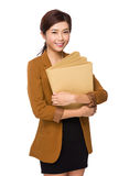 Businesswoman hold lots of file Stock Photo