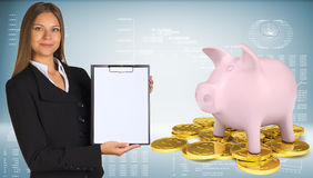 Businesswoman hold paper holder. Piggy bank with Royalty Free Stock Photography