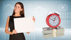 Businesswoman hold paper sheet. Alarm clock stand Stock Photo