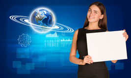 Businesswoman hold paper sheet. Earth and graphs Stock Image