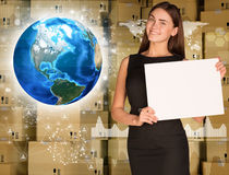 Businesswoman hold paper sheet. Earth and wall of Royalty Free Stock Photos