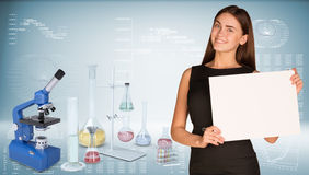 Businesswoman hold paper sheet. Microscope and Royalty Free Stock Image