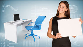 Businesswoman hold paper sheet. Office table with Stock Photography