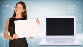 Businesswoman hold paper sheet. Open laptop with Stock Photo