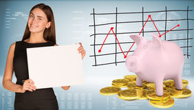 Businesswoman hold paper sheet. Pink piggy bank Stock Image