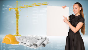 Businesswoman hold paper sheet. Tower crane and Royalty Free Stock Photos