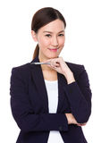 Businesswoman hold with a pen Stock Photos