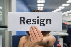 Businesswoman hold resignation paper in office to quit the job. Close up businesswoman hold resignation paper in office to quit the job royalty free stock photos