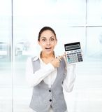 Businesswoman hold show calculator point finger Stock Images