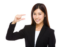 Businesswoman hold with small thing on hand Stock Images