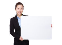Businesswoman hold with white banner Stock Photos