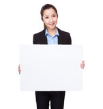 Businesswoman hold with white card board Stock Photos