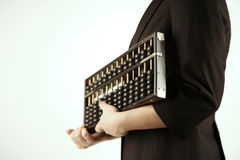 Businesswoman holding an abacus Stock Photo
