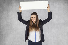 Businesswoman holding ad overhead Royalty Free Stock Image