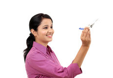 Businesswoman holding airplane miniature Stock Images