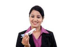 Businesswoman holding airplane miniature Royalty Free Stock Images