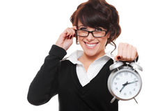 Businesswoman holding alarm clock Stock Photo