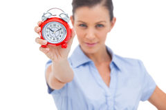 Businesswoman holding alarm clock Stock Images