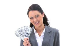 Businesswoman holding American banknotes is smiling Royalty Free Stock Photography