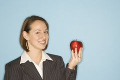 Businesswoman holding apple. Royalty Free Stock Image