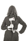 Businesswoman holding an axe behind her back, bw Stock Photo