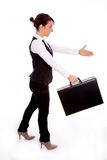 Businesswoman holding bag and offering handshake Royalty Free Stock Photo