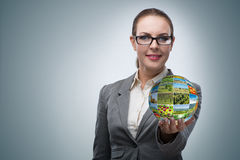 The businesswoman holding the ball with nature photos Royalty Free Stock Photo