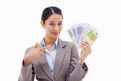 Businesswoman holding bank notes Stock Images