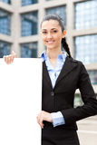 Businesswoman holding big blank paper Royalty Free Stock Photo