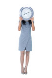 Businesswoman holding big clock in front of her face Royalty Free Stock Images