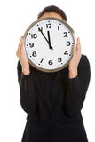 Businesswoman holding a big clock. Stock Image