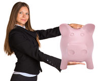 Businesswoman holding big piggy bank. Isolated on white background Stock Images
