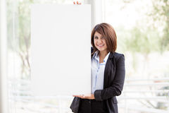 Businesswoman holding a big sign Royalty Free Stock Photography