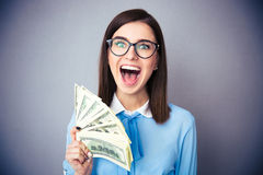 Businesswoman holding bill of dollars and screaming Royalty Free Stock Photography