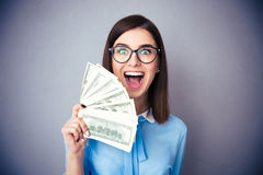 Businesswoman holding bill of dollars and shouting Stock Image