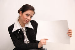 Businesswoman holding a billboard Royalty Free Stock Photos